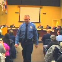 Officer Darren Wilson, whose shooting of a teen sparked protests in Ferguson, Missouri, attends a city council meeting Feb. 11. in footage released by authorities. | AP