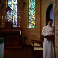 A Catholic priest enters the altar AUg. 6 at the Yakhyeon Catheral in Seoul. When Pope Francis visits South Korea on Thursday, he will find a thriving Catholic community with a social and political influence that belies its minority status in one of Christianity's most muscular Asian strongholds. | AFP-JIJI