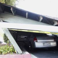 A car lies beneath a collapsed parking structure in Napa, California, after a 6.0-magnitude earthquake rocked the area north of San Francisco early Sunday. | REUTERS