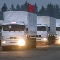 Part of a convoy of 280 Russian trucks leaves Alabino, outside Moscow, for eastern Ukraine on Tuesday, a day after an agreement was reached on an international humanitarian relief mission. But the Red Cross, which is to coordinate the operation, said it had no information on what the trucks were carrying or where they were going. | AP