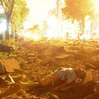 A person is seen lying on the ground after explosions rocked Kaohsiung, southern Taiwan, late Thursday and early Friday.   REUTERS