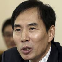 Kim Soo-chang, former chief prosecutor on Jeju Island, speaks at the Jeju Supreme Prosector Office on Dec. 24, 2013, on the island in South Korea. | AP
