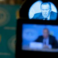 Russian Foreign Minister Sergey Lavrov is shown on a TV camera viewfinder as he speaks in Moscow on Monday. Russia has announced plans to send a second aid convoy to rebel-held eastern Ukraine, where months of fighting have left many residential buildings in ruins. Lavrov said Monday that Russia had notified the Ukrainian government that it was preparing to send a second convoy along the same route in the coming days. | AP