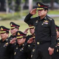 Newly appointed Thai Prime Minister Prayuth Chan-ocha (front) reviews an honor guard during his visit at the 2nd Infantry Battalion, 21st Infantry Regiment, Queen's Guard in Chonburi province, on the outskirts of Bangkok, on Thursday.  | REUTERS
