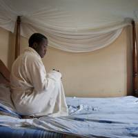 A Ugandan homosexual man sits in the one-room safe house where he was living, at an undisclosed location in Uganda in March. A Ugandan court on Friday invalidated an anti-gay bill signed into law earlier this year, saying the measure is illegal because it was passed during a parliamentary session that lacked a quorum. | AP