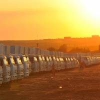 Trucks of the second humanitarian aid convoy to eastern Ukraine stand parked in the sunset near the Russian town of Donetsk on Saturday. Russia hopes to send the second aid convoy to eastern Ukraine soon. The point where the convoy is to cross the border is still unknown.   AP
