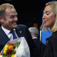 Newly elected European Council President Donald Tusk and newly elected European High Representative for Foreign Affairs Minister Federica Mogherini talk during a EU summit in Brussels on Saturday.   REUTERS
