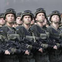 Ukrainian soldiers march through Kiev on Sunday as they take part in a military parade to mark the 23rd anniversary of Ukraine's independence. President Petro Poroshenko vowed to boost military spending by 40 billion hryvnia ($3 billion) over the next three years to fight pro-Russian separatists in the east.   AP