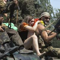 Pro-Russian rebels shoot in the air as they celebrate Paratroopers' Day in the eastern Ukrainian city of Donetsk on Saturday. Many of the rebels have past experience as paratroopers in the Soviet and Russian armies. | AP