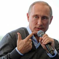 Russian President Vladimir Putin speaks Friday during a youth forum at Lake Seliger, in the north. Putin insisted that Kiev must enter substantial talks with pro-Russian rebels amid a dramatic escalation of the fighting in Ukraine. | AFP-JIJI