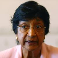 U.N. Human Rights Commissioner Navi Pillay, a native of South Africa, speaks Tuesday at her office in Geneva on the clashes in Ferguson, Missouri. | REUTERS