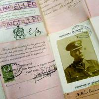 Sir Arthur Conan Doyle's passport dating from World War I is displayed at Christie's auction house in London. The author met with troops in the spring of 1916 and completed his work 'A Visit To Three Fronts' over the summer. | AP
