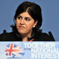 Then-Chairman of the Conservative Party Sayeeda Warsi delivers a speech in Birmingham, central England, on Oct. 3, 2010. The first Muslim woman to sit in the Cabinet, Warsi resigned Tuesday over the British government's policy on Gaza. | AFP-JIJI
