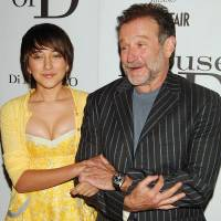 Actors Robin Williams and his daughter, Zelda Williams, pose for photographers during the premiere of their film 'House of D' in New York on April 10, 2005. Zelda Williams has said she was the target of abuse on social-networking sites after her Oscar-winning father was found dead Monday in an apparent suicide at his Northern California home. | REUTERS