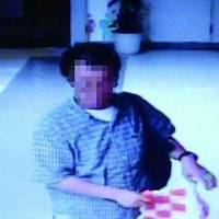 This image captured by a security camera shows a man who allegedly stole a toy robot priced at ¥250,000 from Mandarake, a shop in Tokyo's Nakano Ward, on Aug. 4.   KYODO