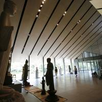 A visitor is seen in an exhibition hall at Nezu Museum in Tokyo on July 17. | AP