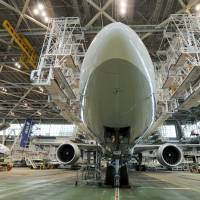 An ANA 777-300ER sits in the airline's hanger at Narita International Airport in April 2010. The government on Tuesday officially chose two Boeing 777-300ERs as its official jets to be used from fiscal 2019, with ANA as the maintenance service provider. | BLOOMBERG