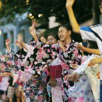 Children dance during the Tsukudajima Bon Festival on July 14 in Chuo Ward, Tokyo. | KYODO