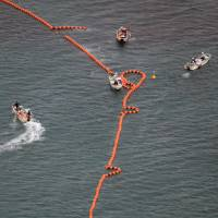Buoys are installed Thursday off Henoko, Okinawa Prefecture, for seabed drilling in preparation of land reclamation. | KYODO