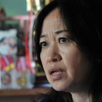 Veteran foster mother Mika Hobbs talks about taking in and raising abused and neglected children, during a recent interview at her home in Machida, western Tokyo. | YOSHIAKI MIURA