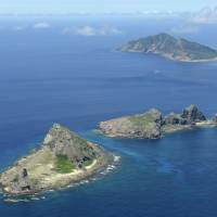 The Senkaku islets (front to back) of Minamikojima, Kitakojima and Uotsurishima are seen in September 2012. | KYODO