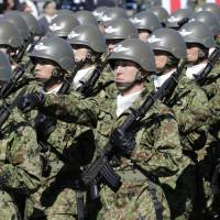 Soldiers march at the Asaka Base in Saitama Prefecture during Self-Defense Forces Day, on Oct. 27, 2013. | AP