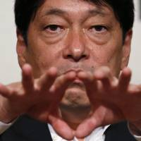 Defense Minister Itsunori Onodera gives a speech at the Asian Affairs Research Council in Tokyo on Monday. | REUTERS