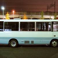 A police van from which a 17-year-old boy escaped Thursday night is seen at the Urayasu Police Station in Chiba Prefecture. He was caught about an hour later. | KYODO
