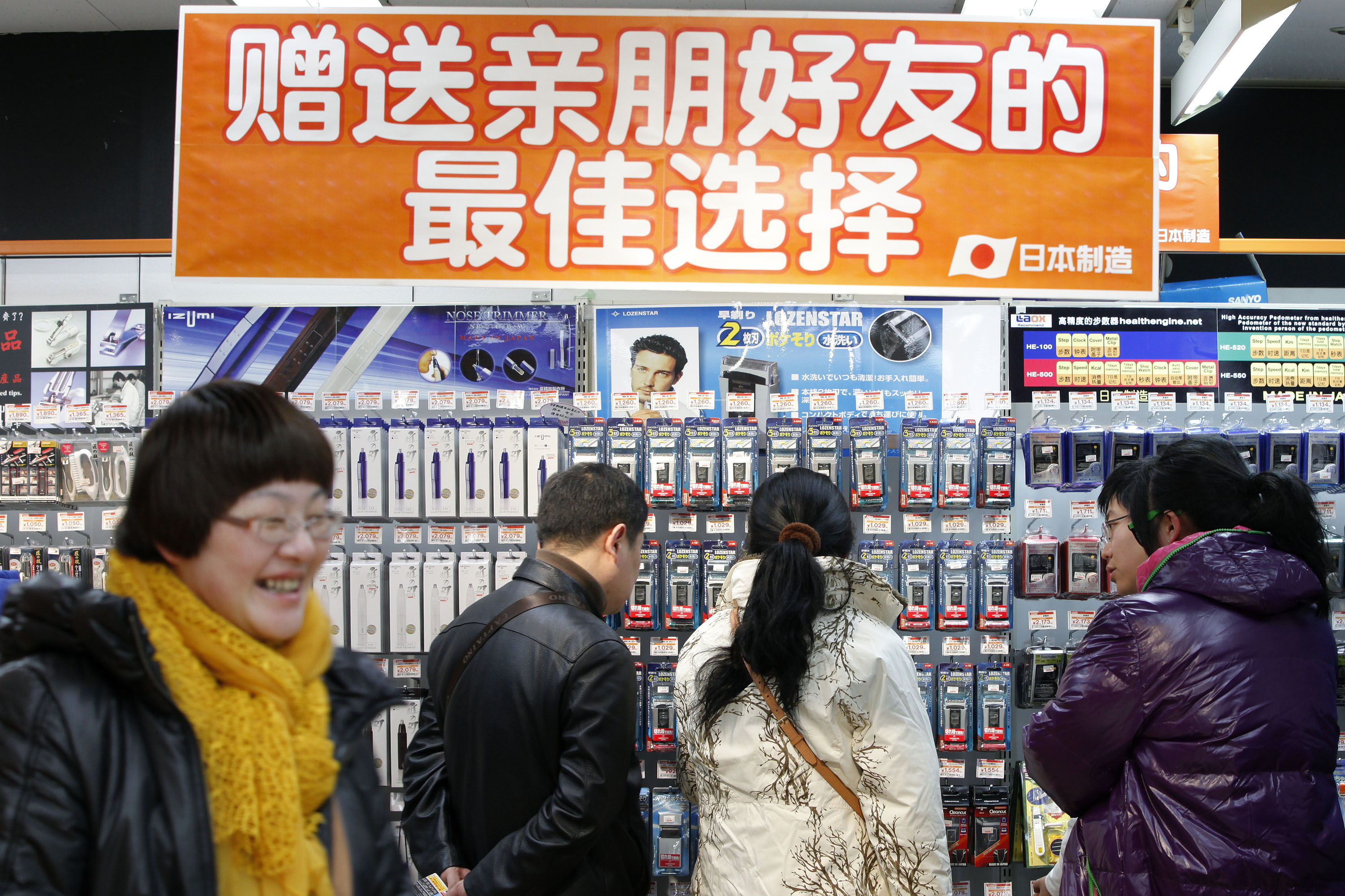 Chinese tourists browse through a Laox electronics store in Tokyo's Akihabara district on Jan. 23, 2012. | BLOOMBERG