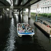 A party boat navigates a waterway in the district.   YOSHIAKI MIURA