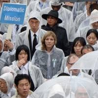 U.S. Ambassador to Japan Caroline Kennedy (center) leaves a memorial service marking the 69th anniversary of the Aug. 6, 1945, atomic bombing of Hiroshima by the United States at the city's Peace Memorial Park on Wednesday. | AFP-JIJI