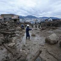 Search for missing in Hiroshima mudslide continues, as victims mourned