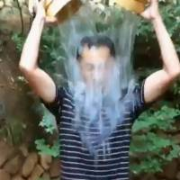 Renowned stem cell researcher and Nobel laureate Shinya Yamanaka takes the Ice Bucket Challenge to raise awareness for ALS research, in this screen shot taken from a YouTube video. | KYODO