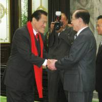 Opposition lawmaker Antonio Inoki meets with Kim Yong Nam, North Korea's ceremonial head of state, in Pyongyang on Saturday. | KYODO