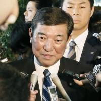 Liberal Democratic Party Secretary-General Shigeru Ishiba takes questions from reporters after meeting Prime Minister Shinzo Abe on Friday at the prime minister's office in Tokyo. | KYODO
