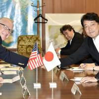 Howard McKeon (left), chairman of the U.S. House of Representatives Armed Services Committee, shakes hands with Defense Minister Itsunori Onodera at the Defense Ministry on Sunday. | KYODO
