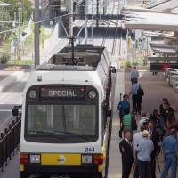 A light rail train stops at a station adjacent to Dallas-Fort Worth International Airport during a demonstration ride for the media in July.   KYODO