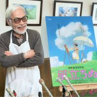 Anime director Hayao Miyazaki speaks to reporters in March at his studio in Koganei, western Tokyo. Next to him is a poster for his film 'Kaze Tachinu' ('The Wind Rises'), which was nominated for best animated feature at last year's Academy Awards. | KYODO