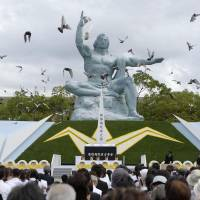 Doves are released at Nagasaki's Peace Park on Saturday as the city marked the 69th anniversary of its atomic bombing. | KYODO