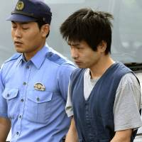 Shogo Kina leaves Shibata Police Station in Niigata Prefecture on Friday, following his arrest the day before. | KYODO