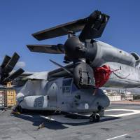 An MV-22 Osprey sits aboard the new amphibious assault ship USS America (LHA6) at Pier Maua in Rio de Janeiro on Wednesday. The America, which can can also emulate the functions of a standard aircraft carrier, is on its maiden voyage around the Americas. | AFP-JIJI