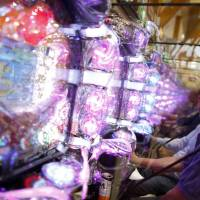 Visitors play at a Dynam pachinko parlor in Fuefuki, Yamanashi Prefecture, on June 19. | REUTERS