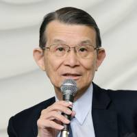 Teruo Kishi, head of an independent reform panel at Riken, holds a news conference on June 12 in Minato Ward, Tokyo. | KYODO