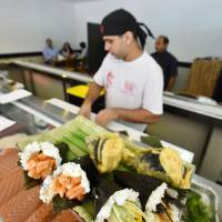 'Temaki' hand-rolled sushi are offered at a Japanese restaurant in Rio de Janeiro on July 13. | KYODO