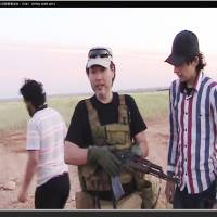 A screen shot from a YouTube video purportedly shot in Syria shows a man thought to be Japanese security contractor Haruna Yukawa.