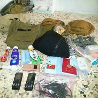 Items described by Islamic Front militants as the personal possessions of Haruna Yukawa, a Japanese citizen reported to have been captured by rival Islamic State fighters. His reasons for traveling to Syria remain unclear.  | KYODO