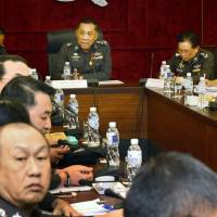 Thai police officials hold a meeting Tuesday over a Japanese businessmen believed to be the father of several surrogate babies found in a Bangkok condominium. | KYODO