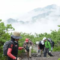 Climbers head for the summit of 1,729-meter-high Mount Daisen in Tottori Prefecture in June. | KYODO
