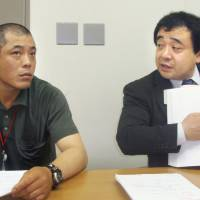 Lawyer Shoichi Ibuski (right), describes the poor working conditions participants are forced to endure in the government's foreign trainee program, in June 2009. Experts say trainees are exploited to the extent that some die from overwork or commit suicide. | KYODO