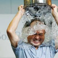 SoftBank CEO Masayoshi Son takes part in an ice bucket challenge to raise money to fight ALS at the company's Tokyo headquarters Wednesday.  | REUTERS
